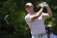 Rory McIlroy tees off on the seventh hole during the fourth round of the Wells Fargo Championship golf tournament at Quail Hollow on Sunday, May 9, 2021, in Charlotte, N.C. (AP Photo/Jacob Kupferman)
