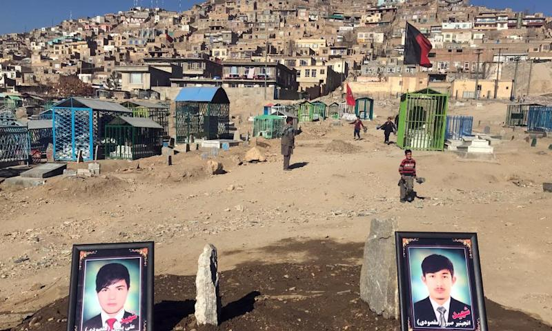 The photos of two brothers, who were killed in a suicide attack that targeted a Shia cultural centre in Kabul, Afghanistan.