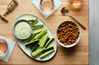 """Chickpeas are high in protein and make a shockingly delicious snack when you roast them until they're crispy—and they're easy to toss in a baggie for a picnic. <a href=""""https://www.epicurious.com/recipes/food/views/crispy-curry-roasted-chickpeas-56389735?mbid=synd_yahoo_rss"""" rel=""""nofollow noopener"""" target=""""_blank"""" data-ylk=""""slk:See recipe."""" class=""""link rapid-noclick-resp"""">See recipe.</a>"""