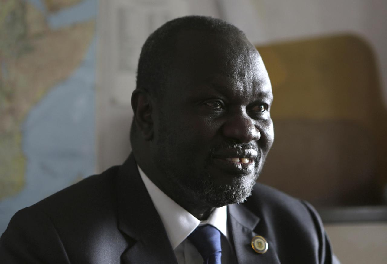 South Sudan rebel leader Riek Machar speaks in an interview with The Associated Press in Johannesburg, on Thursday, Oct. 20, 2016. Machar says a political process is needed to revive a peace deal that has collapsed in his country. (AP Photo/Denis Farrell)