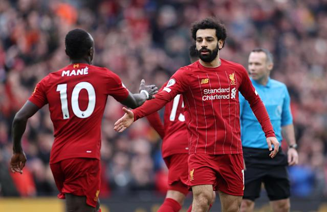 First-half goals by Mohamed Salah (right) and Sadio Mane sent Liverpool on its way after a slow start. (Reuters/Carl Recine)