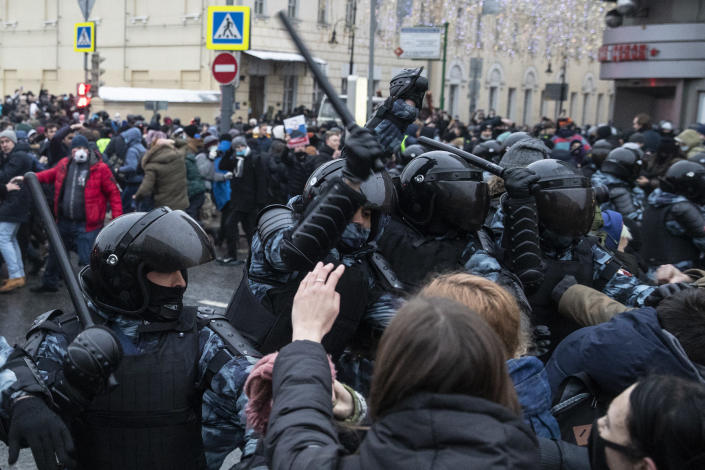 Police officers clash with people during a protest against the jailing of opposition leader Alexei Navalny in Moscow, Russia, Saturday, Jan. 23, 2021. Russian police on Saturday arrested hundreds of protesters who took to the streets in temperatures as low as minus-50 C (minus-58 F) to demand the release of Alexei Navalny, the country's top opposition figure. (AP Photo/Pavel Golovkin)