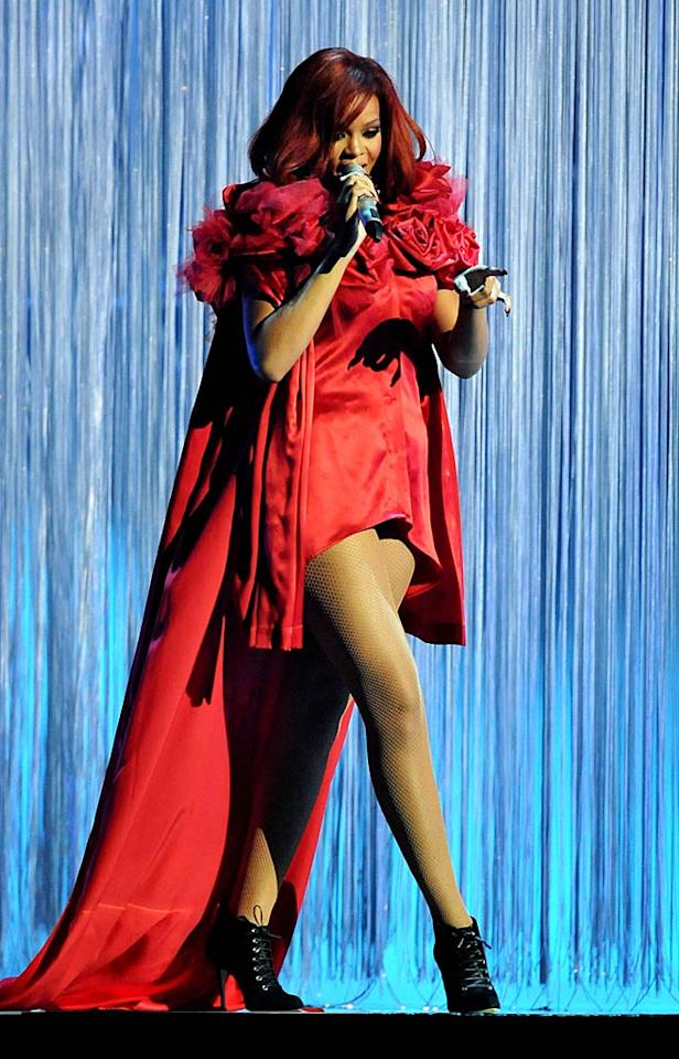 "Later that evening, RiRi rocked the crowd at London's O2 arena with a medley of her hits, including ""S&M,"" ""What's My Name?,"" and ""Only Girl (In the World)"", while wearing a scarlet micro-mini and matching cape. Jon Furniss/<a href=""http://www.wireimage.com"" target=""new"">WireImage.com</a> - February 15, 2011"