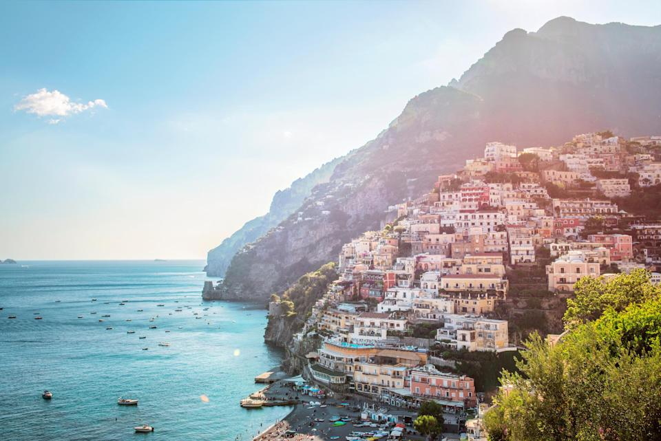 'Positano's steep slopes are periwinkled in lemon, pistachio and peachy-pink painted houses' - getty