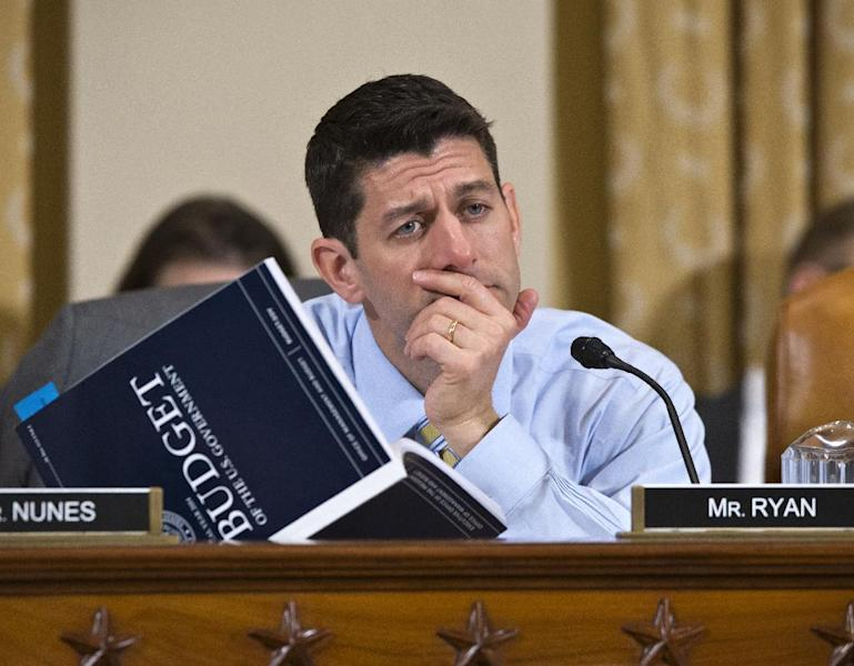 House Budget Committee Chairman Rep. Paul Ryan, R-Wis., a member of the House Ways and Means Committee, holds a copy of President Barack Obama's fiscal 2014 budget proposal book as he questions Health and Human Services (HHS) Secretary Kathleen Sebelius on Capitol Hill in Washington, Friday, April 12, 2013, as Sebelius testified before the House Ways and Means Committee hearing on the HHS fiscal 2014 budget request. (AP Photo/J. Scott Applewhite)