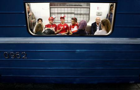 Soccer fans from Denmark are seen inside a metro at a subway station on the second day of the 2018 FIFA World Cup in Moscow, Russia, June 15, 2018. REUTERS/Christian Hartmann