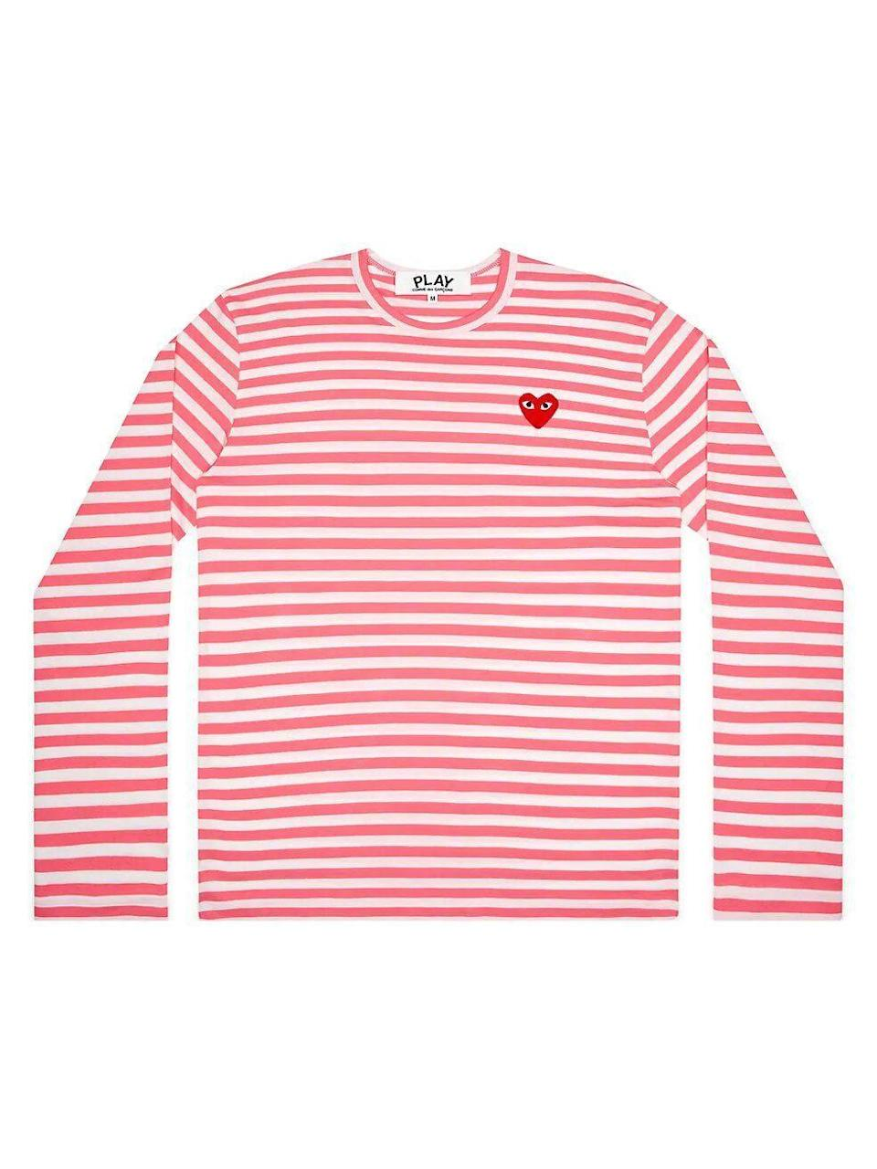 "<p><strong>Comme des Garcons Play</strong></p><p>saksfifthavenue.com</p><p><strong>$139.00</strong></p><p><a href=""https://go.redirectingat.com?id=74968X1596630&url=https%3A%2F%2Fwww.saksfifthavenue.com%2Fproduct%2Fcomme-des-garcons-play-striped-long-sleeve-shirt-0400012706854.html%3Fdwvar_0400012706854_color%3DPINK&sref=https%3A%2F%2Fwww.townandcountrymag.com%2Fstyle%2Ffashion-trends%2Fg35229634%2Fbarneys-at-saks-launch%2F"" rel=""nofollow noopener"" target=""_blank"" data-ylk=""slk:Shop Now"" class=""link rapid-noclick-resp"">Shop Now</a></p>"