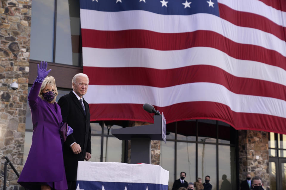 "President-elect Joe Biden stands with his wife Jill Biden after speaking at the Major Joseph R. ""Beau"" Biden III National Guard/Reserve Center, Tuesday, Jan. 19, 2021, in New Castle, Del. (AP Photo/Evan Vucci)"