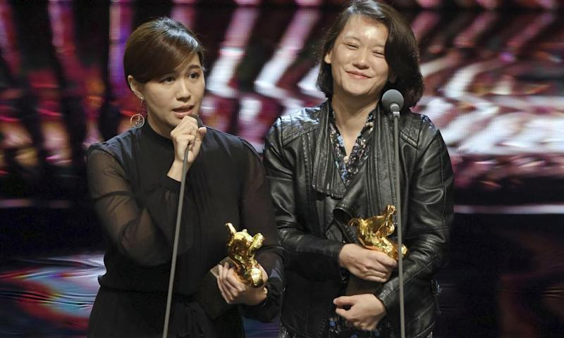 Taiwanese director Fu Yue, left, delivers a speech next to producer Hong Ting Yi after she won Best Documentary at the 55th Golden Horse Awards in Taipei