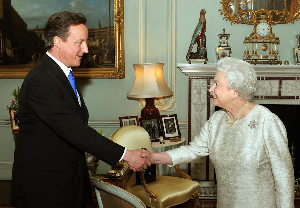 Britain's Queen Elizabeth II greets David Cameron at Buckingham Palace in an audience to invite him to be the next Prime Minister following last week's General Election.