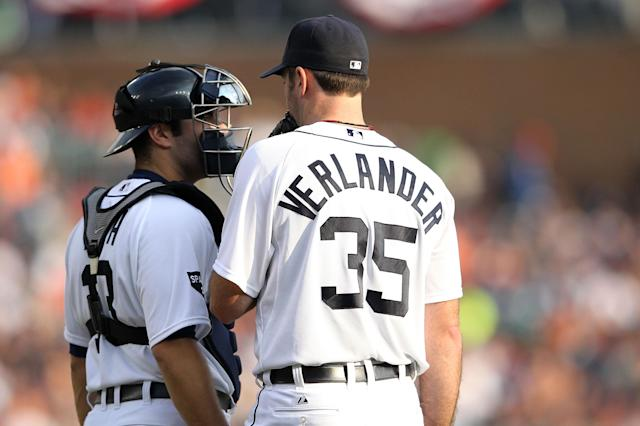 DETROIT, MI - OCTOBER 13: Justin Verlander #35 speaks with Alex Avila #13 of the Detroit Tigers during Game Five of the American League Championship Series against the Texas Rangers at Comerica Park on October 13, 2011 in Detroit, Michigan. (Photo by Leon Halip/Getty Images)