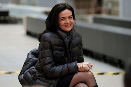 Sheryl Sandberg, Chief Operating Officer of Facebook, listens to speeches during a visit in Paris