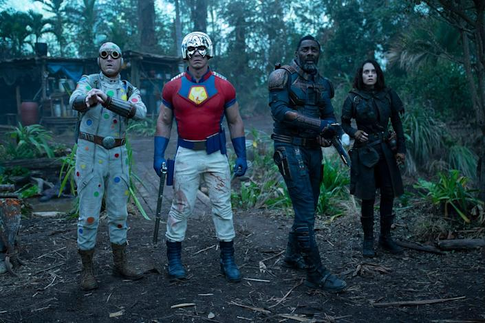 """Polka-Dot Man (David Dastmalchian, from left), Peacemaker (John Cena), Bloodsport (Idris Elba) and Ratcatcher 2 (Daniela Melchior) are the newcomers to Task Force X in James Gunn's """"The Suicide Squad."""""""