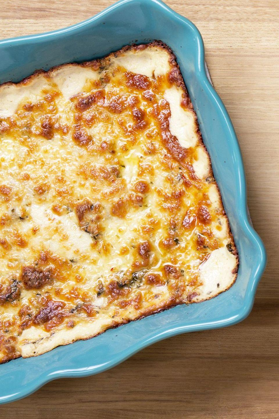 """<p>Bring this warm, cheesy dip to your Friendsgiving potluck and everyone will be asking for the recipe. You'll want to make it again and again. </p><p><a href=""""https://www.thepioneerwoman.com/food-cooking/recipes/a11384/the-best-spinach-artichoke-dip-ever/"""" rel=""""nofollow noopener"""" target=""""_blank"""" data-ylk=""""slk:Get Ree's recipe."""" class=""""link rapid-noclick-resp""""><strong>Get Ree's recipe.</strong></a></p>"""