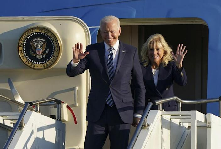 US President Joe Biden and First Lady Jill Biden wave as they arrive aboard Air Force One at RAF Mildenhall, England, ahead of the G7 summit in Cornwall, Wednesday June 9, 2021. Biden will attend the G7 summit in Cornwall, southwest England. (Joe Giddens/Pool via AP)