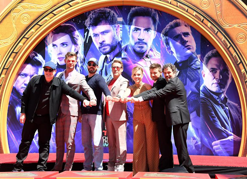 "HOLLYWOOD, CALIFORNIA - APRIL 23: President of Marvel Studios/Producer Kevin Feige, Chris Hemsworth, Chris Evans, Robert Downey Jr., Scarlett Johansson, Jeremy Renner, and Mark Ruffalo poses at the Marvel Studios' ""Avengers: Endgame"" Cast Place Their Hand Prints In Cement At TCL Chinese Theatre IMAX Forecourt at TCL Chinese Theatre IMAX on April 23, 2019 in Hollywood, California. (Photo by Steve Granitz/WireImage)"