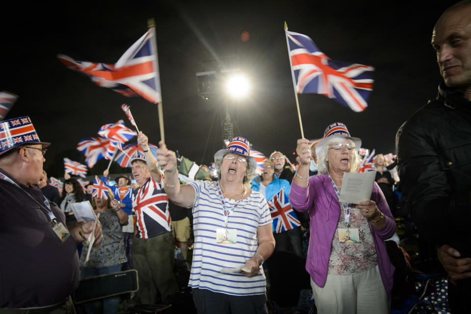 Festival goers sing Rule Brittania at BBC Proms in the Park, in Hyde Park, London. PRESS ASSOCIATION Photo. Picture date: Saturday September 10, 2016. Photo credit should read: Matt Crossick/PA Wire.