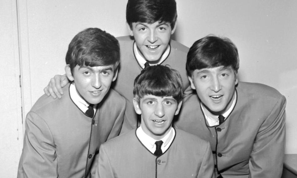 The Beatles in Cardin collarless jackets in 1963.