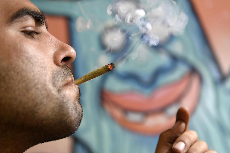 A picture taken on July 9, 2014 shows a member of the Catalan Federation of Cannabis Association smoking marijuana in Barcelona (AFP Photo/Lluis Gene)