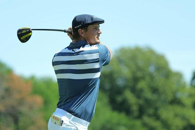 American Bryson DeChambeau finished with three straight birdies to win the Rocket Mortgage Classic on Sunday in Detroit (AFP Photo/Leon Halip)
