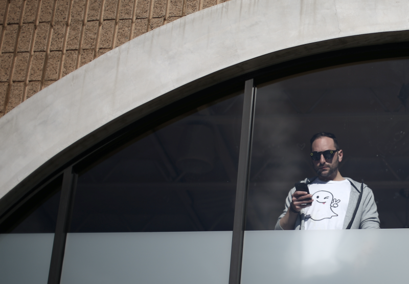 A Snap Inc. employee watches out an office window in Venice Beach, California, U.S. March 2, 2017. (Photo: REUTERS/ Lucy Nicholson)
