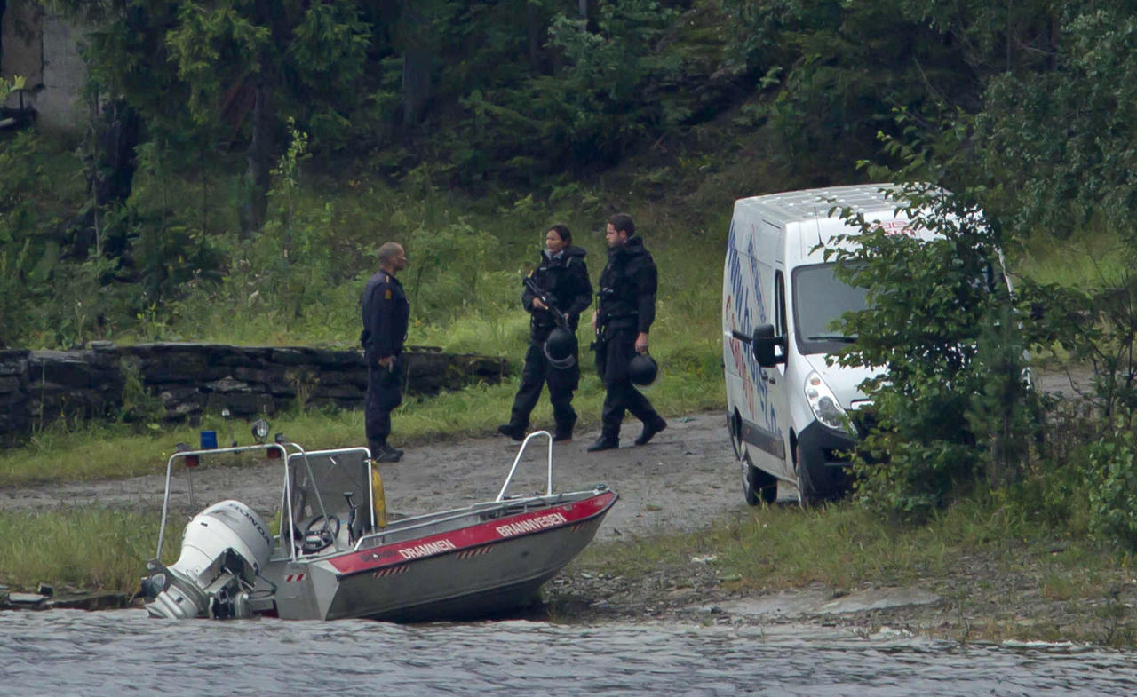Armed police officers are seen on the island of Utoya, Norway Saturday, July 23, 2011. The 32-year-old man suspected in bomb and shooting attacks that killed at least 91 people in Norway bought six tons of fertilizer before the massacres, the supplier said Saturday as police investigated witness accounts of a second shooter. Norway's prime minister and royal family visited grieving relatives of the scores of youth gunned down in a horrific killing spree on an idyllic island retreat. A man who said he was carrying a knife was detained by police officers outside the hotel, as the shell-shocked Nordic nation was gripped by reports that Norwegian gunman may not have acted alone. (AP Photo/Matt Dunham)
