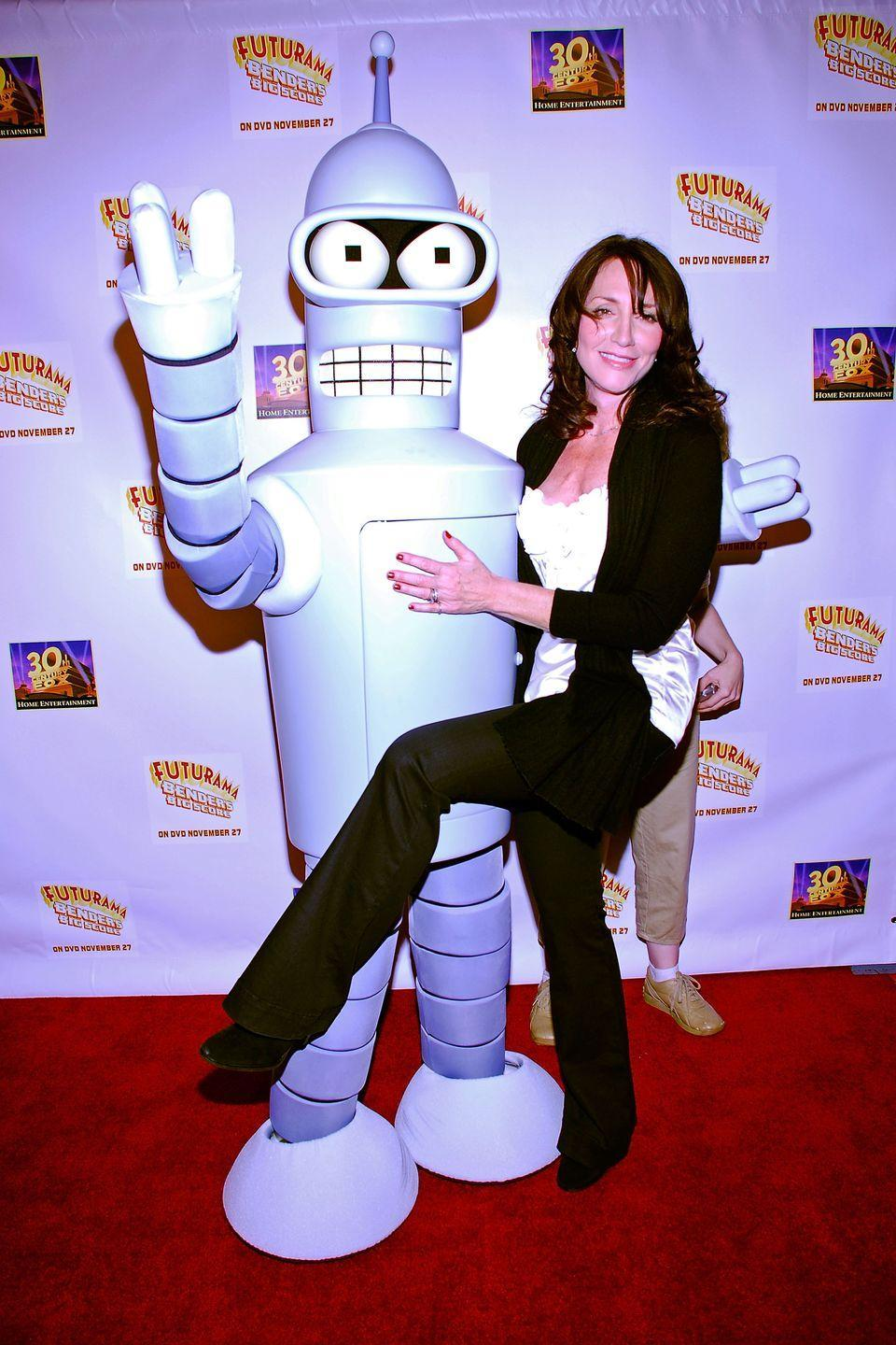<p>If Katey Sagal looks familiar, that's because she was Peg Bundy on the long-running sitcom <em>Married... with Children</em> and also the badass Gemma Teller Morrow on <em>Sons of Anarchy.</em> She's also the voice of Leela, the stunning one-eyed alien on <em>Futurama</em>. </p>