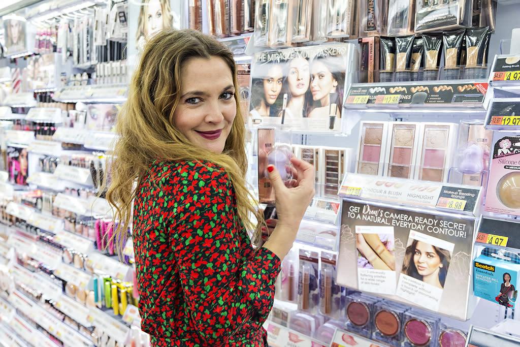 <p>The <i>Never Been Kissed</i> star browsed her own Flower makeup collection in the beauty aisle at a Walmart in Bentonville, Ark. How excited do you think the other shoppers were to see <i>her</i>? (Photo: Wesley Hitt/Getty Images for Walmart) </p>