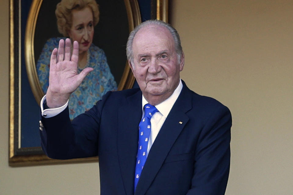 FILE - In this June 2, 2019 file photo, Spain's former King Juan Carlos waves during a bullfight at the bullring in Aranjuez, Madrid, Spain. Afghan President Ashraf Ghani, driven out by the Taliban, is the latest leader on the run to turn up in the United Arab Emirates. Others who found refuge in the Gulf Arab state include Spain's disgraced King Juan Carlos who is facing financial probe, ex-Pakistani Prime Minister Benazir Bhutto, and former Thai prime ministers. (AP Photo/Andrea Comas, File)