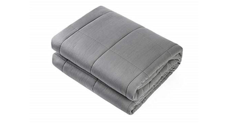This 15lb weighted blanket with premium glass beads was designed to relax by simulating the feeling of being held or hugged (Photo: Amazon)