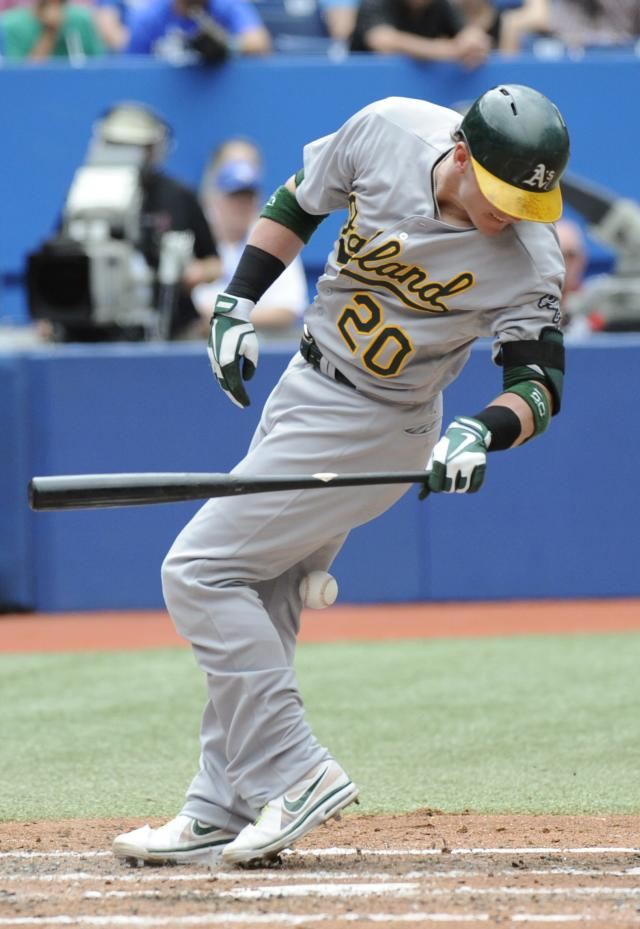 Oakland Athletics' Josh Donaldson is hit by a pitch from Toronto Blue Jays pitcher R.A. Dickey during the fourth inning of a baseball game on Sunday, Aug. 11, 2013, in Toronto. (AP Photo/The Canadian Press, Jon Blacker)