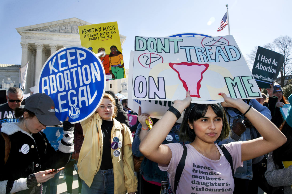 Abortion rights demonstrators rally outside the Supreme Court with signs reading