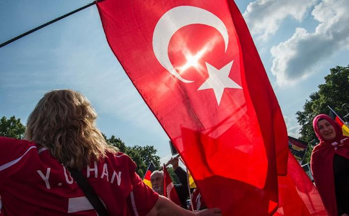 People with Turkish flags protest in Berlin against Germany's resolution recognising the massacre of Armenians by Ottoman forces as genocide (AFP Photo/John MacDougall )
