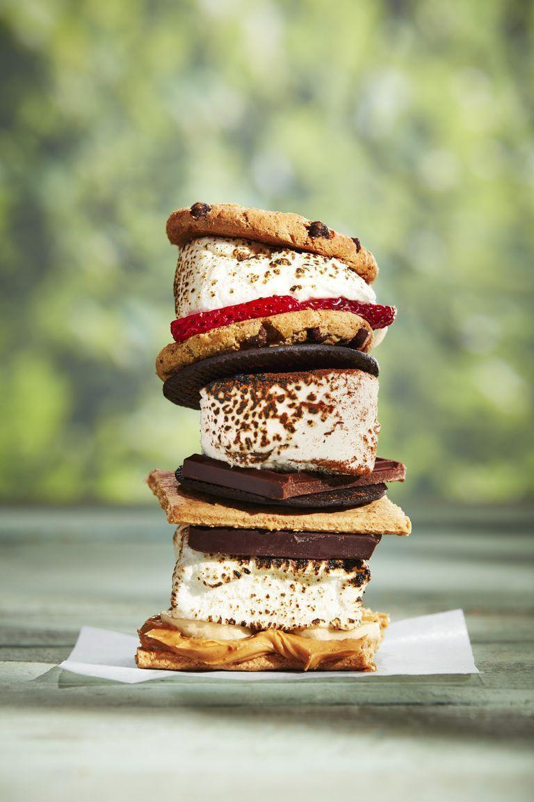"""<p>You had to see this one coming—it's a camping must, especially after a long day of hiking. Revamp the classic graham cracker recipe with tasty additions like chocolate cookies, peanut butter, and strawberries. </p><p><strong><a href=""""https://www.countryliving.com/food-drinks/a28189946/smores-recipe/"""" rel=""""nofollow noopener"""" target=""""_blank"""" data-ylk=""""slk:Get the recipe"""" class=""""link rapid-noclick-resp"""">Get the recipe</a>.</strong> </p>"""