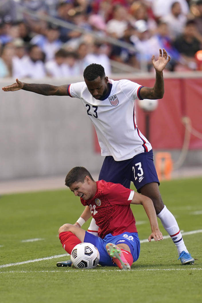 United States' Kellyn Acosta (23) defends against Costa Rica's Joseph Mora (22) during the second half of an international friendly soccer match Wednesday, June 9, 2021, in Sandy, Utah. (AP Photo/Rick Bowmer)