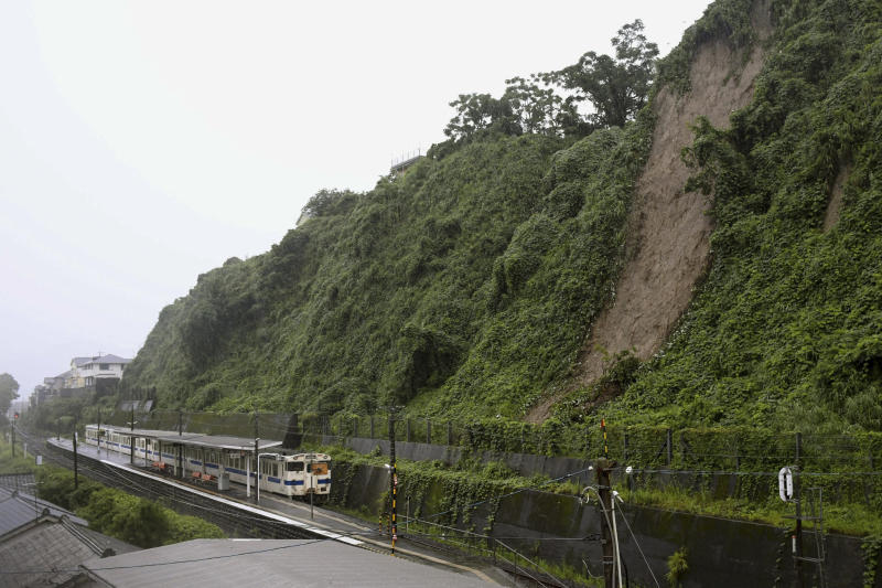 A landslide due to heavy rain is seen nearby a train station Wednesday July 3, 2019 in Kagoshima City, south west of Japan. Japanese authorities have directed more than 1 million residents in parts of the southern main island of Kyushu to evacuate to designated shelters as heavy rains batter the region, prompting fears of landslides and widespread flooding. (Kyodo News via AP)