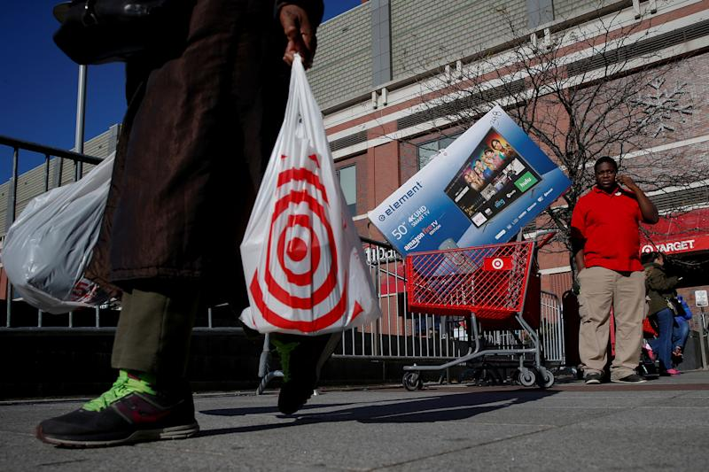 Shoppers exit a Target store during Black Friday shopping in the Brooklyn borough of New York City, U.S., November 24, 2017. REUTERS/Brendan McDermid