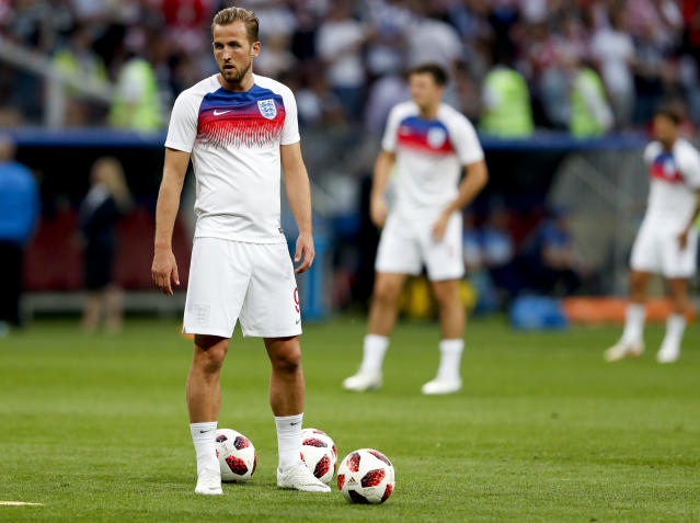 England's Harry Kane stand on the field before the semifinal match between Croatia and England at the 2018 soccer World Cup in the Luzhniki Stadium in Moscow, Russia, Wednesday, July 11, 2018. (AP Photo/Rebecca Blackwell)
