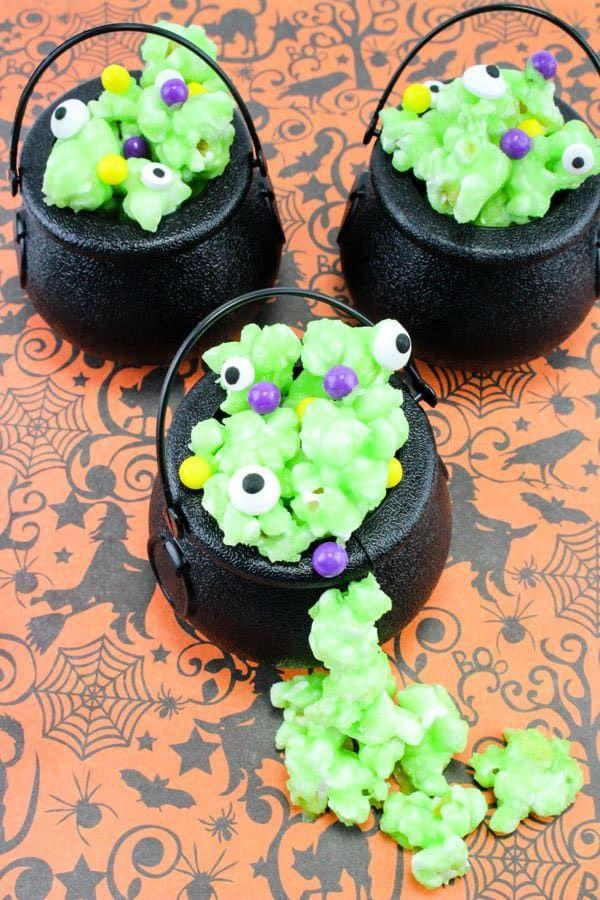 "<p>Popcorn or a puffy potion? It's almost impossible to tell with this delightfully eerie Halloween snack, which little ones will love helping with.</p><p><strong>Get the recipe at <a href=""https://rainydaymum.co.uk/cauldron-popcorn-treats-for-halloween/"" rel=""nofollow noopener"" target=""_blank"" data-ylk=""slk:Rainy Day Mum"" class=""link rapid-noclick-resp"">Rainy Day Mum</a>.</strong></p><p><strong><a class=""link rapid-noclick-resp"" href=""https://www.amazon.com/Ofargo-Cauldron-Multi-purposed-Halloween-Patricks/dp/B0755D2YFX/?tag=syn-yahoo-20&ascsubtag=%5Bartid%7C2139.g.34440360%5Bsrc%7Cyahoo-us"" rel=""nofollow noopener"" target=""_blank"" data-ylk=""slk:SHOP MINI CAULDRONS"">SHOP MINI CAULDRONS</a> </strong></p>"