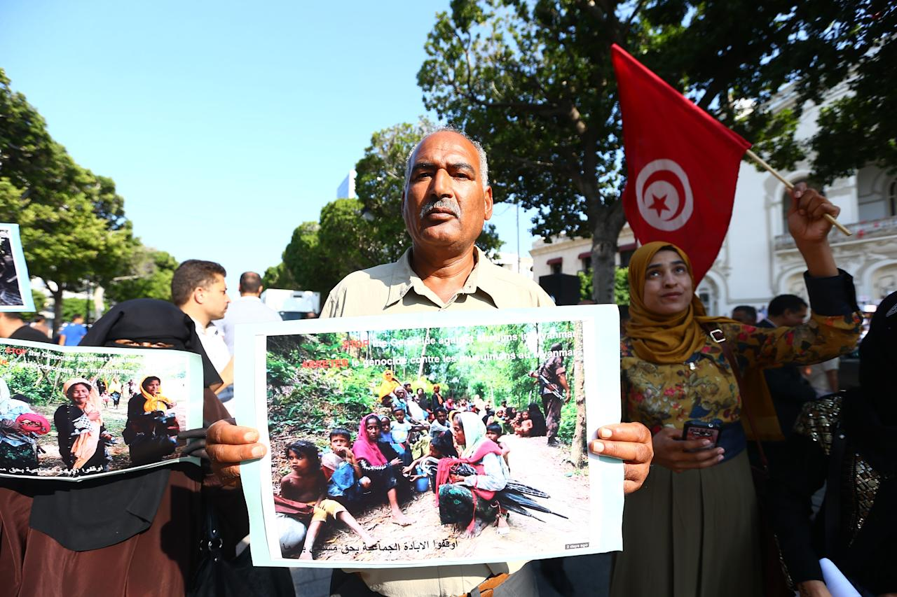 <p>Tunisian demonstrators hold banners during their protest against Myanmar's oppression towards Rohingya Muslims, on Avenue Habib Bourguiba in Tunis, Tunisa, Sept. 8, 2017. (Photo: Yassine Gaidi/Anadolu Agency/Getty Images) </p>