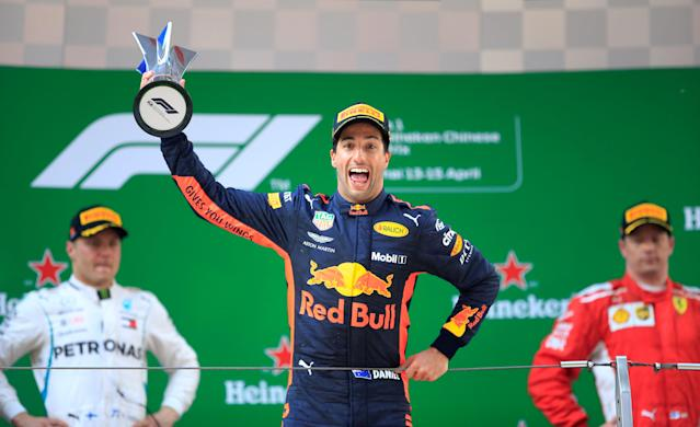 Formula One F1 - Chinese Grand Prix - Shanghai International Circuit, Shanghai, China - April 15, 2018 Red Bull's Daniel Ricciardo celebrates with a trophy on the podium after winning the race as Mercedes' Valtteri Bottas and Ferrari's Kimi Raikkonen look on REUTERS/Aly Song TPX IMAGES OF THE DAY
