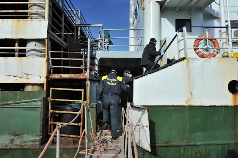 Italian Border Police board the Ezadeen at Corigliano harbour on January 3, 2015, a day after some 500 would-be Syrian immigrants disembarked from the ship (AFP Photo/Alfonso Di Vincenzo)