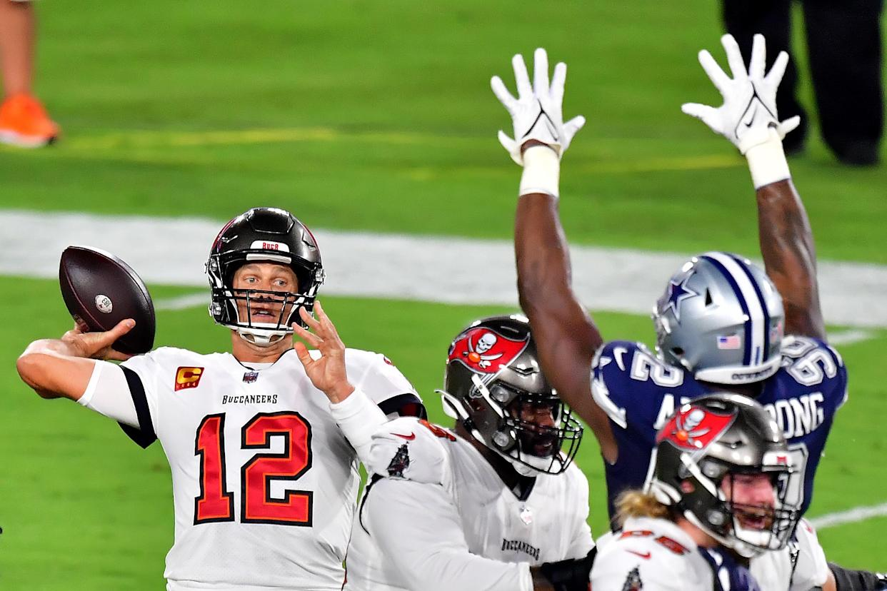 Buccaneers quarterback Tom Brady passes against the Cowboys during the first quarter at Raymond James Stadium on Sept. 9, 2021 in Tampa, Florida. (Photo by Julio Aguilar/Getty Images)