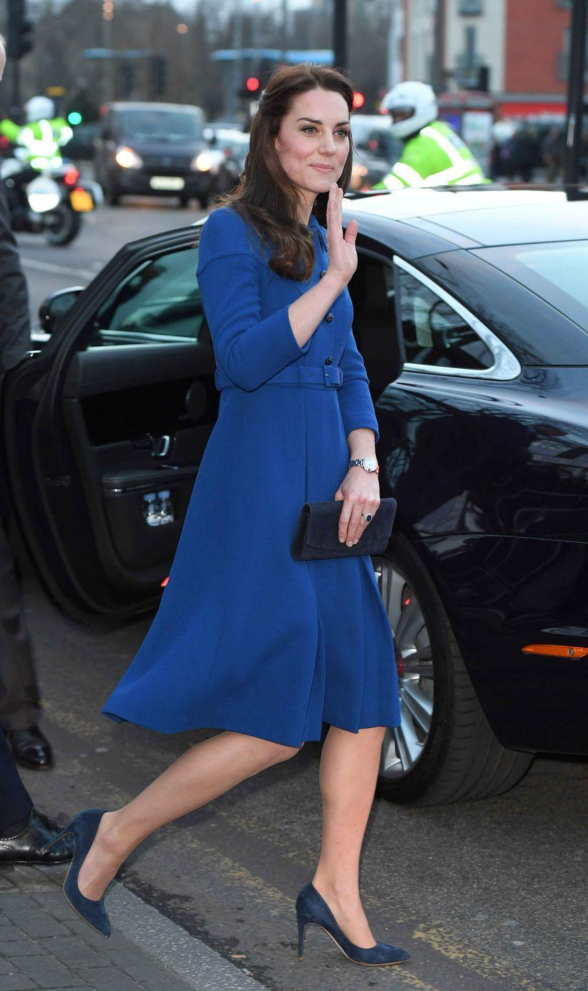 <p>For her first engagement of the year, The Duchess of Cambridge steps out in London wearing a royal blue coat dress by Eponine and navy suede clutch and heels.</p>