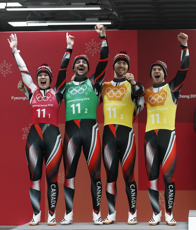 Luge - Pyeongchang 2018 Winter Olympic Games - Team Relay - Pyeongchang, South Korea - February 15, 2018 - Silver medalists Alex Gough, Sam Edney, Tristan Walker and Justin Snith of Canada celebrate during the victory ceremony. REUTERS/Edgar Su