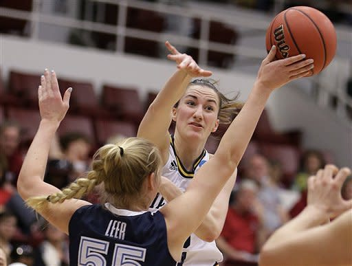 Villanova's Emily Leer (55) blocks the pass of Michigan's Kate Thompson during the first half of a first-round game in the women's NCAA college basketball tournament, Sunday, March 24, 2013, in Stanford, Calif. (AP Photo/Ben Margot)