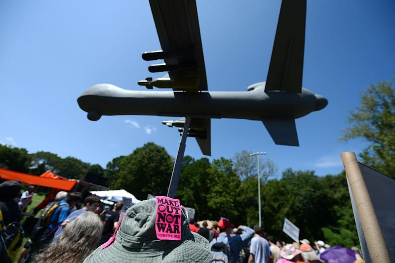 """Protesters against the use of drone strikes demonstrate at the """"March On Wall Street South"""" rally in Charlotte, North Carolina, in 2012 (AFP Photo/Robyn Beck)"""