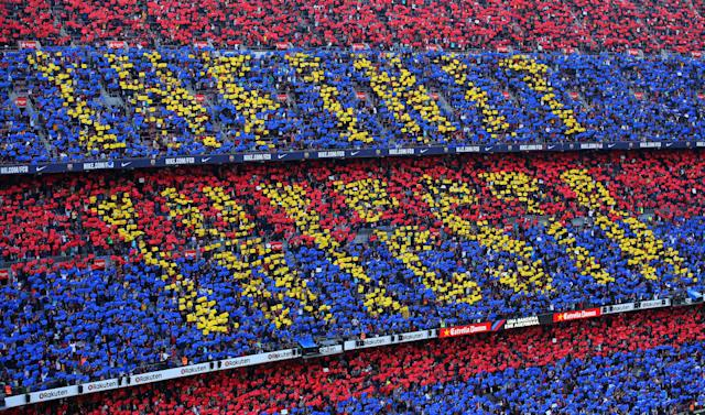 Soccer Football - La Liga Santander - FC Barcelona vs Real Sociedad - Camp Nou, Barcelona, Spain - May 20, 2018 Barcelona fans with a tribute to Barcelona's Andres Iniesta REUTERS/Albert Gea
