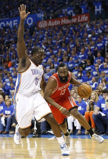 Houston Rockets guard James Harden (13) drives past Oklahoma City Thunder center Kendrick Perkins (5) in the first quarter of Game 1 of their first-round NBA basketball playoff series in Oklahoma City, Sunday, April 21, 2013. (AP Photo/Sue Ogrocki)
