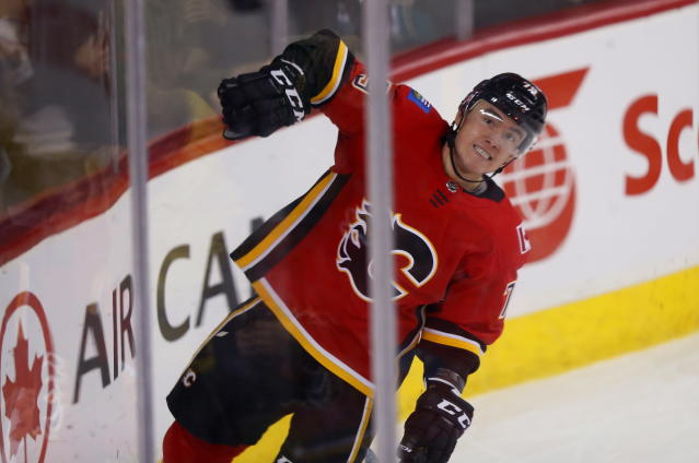 FILE - In this Jan. 6, 2018 file photo Calgary Flames left wing Micheal Ferland (79) celebrates his goal during the first period of an NHL hockey game against the Anaheim Ducks in Calgary, Alberta. The Carolina Hurricanes have acquired defenseman Dougie Hamilton as part of a blockbuster trade with the Flames at the NHL draft. Carolina got Hamilton, winger Micheal Ferland and prospect Adam Fox from Calgary for center Elias Lindholm and defenseman Noah Hanifin. (Todd Korol/The Canadian Press via AP, file)
